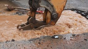 Water pipe break, leaking from hole in a road