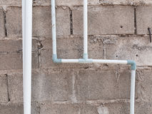 Water pipe at brick wall Royalty Free Stock Photography
