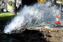 Water Pipe Burst. In City royalty free stock image