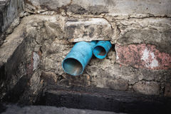 Water pipe in dirty sewer Stock Photography