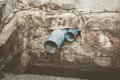 Water pipe in dirty sewer Stock Images