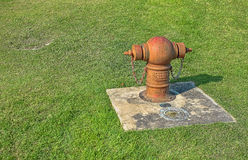 Water pipe and green grass Stock Images
