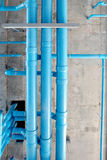 Water pipe hanging in construction site building. Blue color water pipe in construction site Royalty Free Stock Image