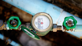 Water pipe and meter with waterspout Royalty Free Stock Photos