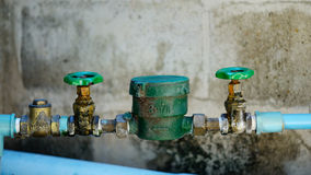Water pipe and meter with waterspout Stock Image