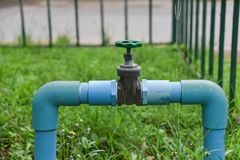 Water pipe valve. Water pipe pvc valve and green grassn royalty free stock photos