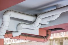 Water pipe system setup on the building. Stock Photos