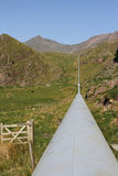 Water pipeline. Water pipeline in the mountains of Snowdonia UK Royalty Free Stock Images
