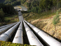 Water pipeline. Transporting water down to a valley accumulation station. Could represent industry infrastructure for urban city areas. Perhaps works with Stock Photography