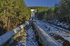 Water pipeline transporting water down to a valley accumulation station in wintertime, Pancharevo Royalty Free Stock Photos