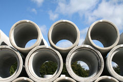 Water pipes. Concrete water pipes stacked in a construction site Stock Photo