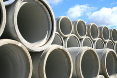 Water pipes. Concrete water pipes stacked in a construction site royalty free stock photography