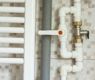 Water pipes in bathroom Royalty Free Stock Image