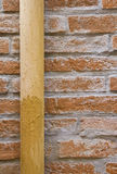 Water pipes on a brick wall. Royalty Free Stock Photos