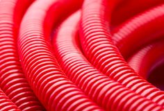 Water pipes. Closeup of long red water pipe Royalty Free Stock Photos