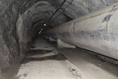 Water pipes. Giant water pipes in a cave stock photos