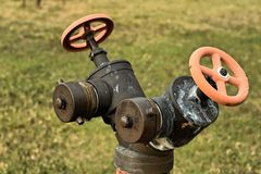A water pipes on the green grass Royalty Free Stock Images