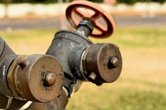 A water pipes on the green grass Stock Photos