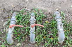 A water pipes on the green grass Royalty Free Stock Photography