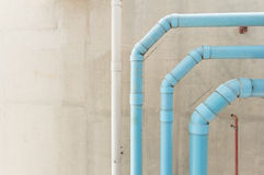 Water pipes hanging on cement ceiling of building Royalty Free Stock Photos