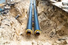 Free Water Pipes In Ground Pit Trench Ditch During Plumbing Under Construction Repairing Stock Photography - 140461182