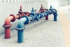 Water pipes joined with valves water supply system. Water pipes joined with valves of the water supply system on a street stock images