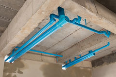 Water pipes pvc plumbing under cement ceiling Stock Photos