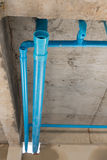 Water pipes pvc plumbing under cement ceiling of second floor. In construction site building Royalty Free Stock Photo