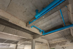 Water pipes pvc plumbing under cement ceiling. Of second floor in construction site building Stock Photography