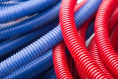 Water pipes. Red and blue water pipes stock photography