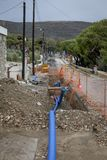 Water Pipes road Works. Road works with new blue water pipes being placed in ground. Stock Image stock photography