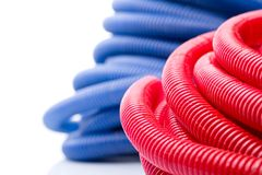 Water pipes. Rolls of red and blue water pipes Royalty Free Stock Photo