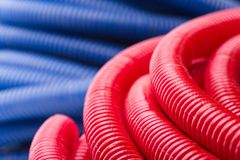 Water pipes. Rolls of red and blue pipes Royalty Free Stock Images