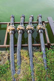 Water pipes to drain the lake. Small pipes used to drain water from the lake Stock Photo