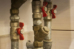 Water pipes and valves connected to heating furnace Royalty Free Stock Image