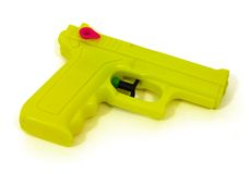 Water Pistol. Yellow water pistol isolated on white Royalty Free Stock Photos