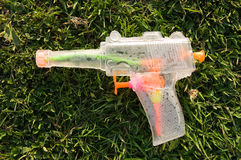 Water pistol lying flat on a lawn Stock Image