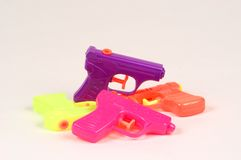 Water Pistols. 4 different colored water pistols made of plastic Royalty Free Stock Photo