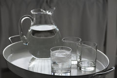 Water pitcher and glasses Stock Image