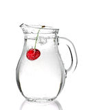 Water pitcher with red cherry. Isolated on white Stock Photos