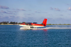 Water Plane in the Maldives taking off royalty free stock images