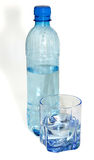 Water in a plastic bottle and a glass glass Stock Photos