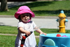 Water Play Fun. Toddler Playing in the water table on a hot day Stock Photos