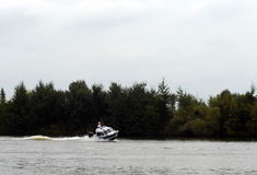 Water police patrol boat on the Moscow River. Stock Photography