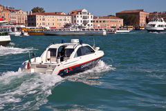 Water police patrol in Venice, Italy Royalty Free Stock Image