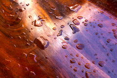 Water on  polished wood Royalty Free Stock Images