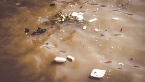 Water pollution caused by dumping plastic waste. Resulting in a bad environment social royalty free stock photos