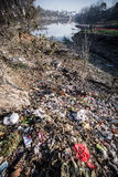 Water pollution in China. Pollution, garbage, and running sewage on the bank of major a river.  Huai River Basin, Henan Province, China Royalty Free Stock Images