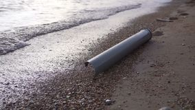 Water pollution plastic pipe at a coast