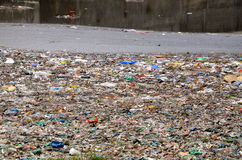 WATER POLLUTION. Pollution from wasteage drain and plastic into river Stock Photography
